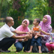 Malay family having fun in the park ,malaysian people — Stock Photo #38375153