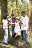 Indian family teaching children to climb — Stock Photo