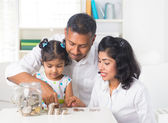 Indian family teaching children on savings and financial plannin — Stock Photo