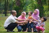 Malay family having fun in the park ,malaysian people — Stock Photo