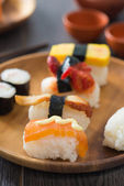 Various sushi on plate — Stock Photo