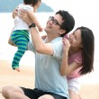 Family playing on the beach — Stock Photo #41542405