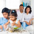 Indian parents teaching children — Stockfoto