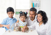 Indian parents teaching children — Stock Photo