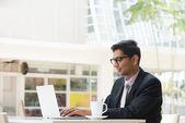 Business man on laptop — Stock Photo