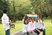 Indian family playing kite in the outdoor park — Stock Photo