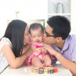 Parents giving baby kiss — ストック写真