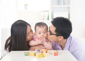 Parents giving baby  kiss — Stock Photo