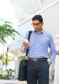 Businessman using a smart phone — Stock Photo