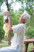 Asian grandfather with son — Stock Photo