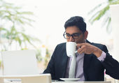 Indian business man at cafe — Stock Photo