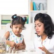 Mother teaching daughter on financial planning — Photo