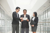 Singaporean business team meeting — Stock Photo