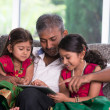 Father with his daughters using a tablet computer — Stock Photo #48123629