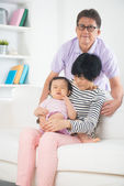 Asian grandparents comforting their grand daugther — Stock Photo