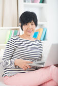 Chinese senior female with laptop — Stock Photo