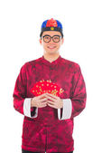 Chinese man with red packets — Stock Photo