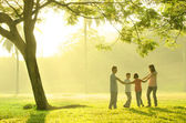 Family  playing together in the park — Stock Photo