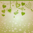 Stock Photo: Heart with green flourishes isolated on white