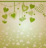Heart with green flourishes isolated on white — Stock Photo