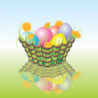 Stock Vector: Easter eggs in basket