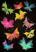 Butterflies black backdrop — Stock Photo