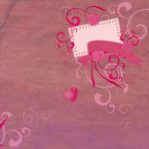 Pink hearts and decor on grunge paper background — Stock Photo