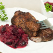 Stock Photo: Eating juicy steak with plum relish
