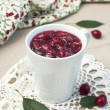 Cup of cornel jam with rosemary - Stock Photo
