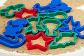 Cookie dough and cookie cutters — Stock Photo