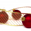 Three red christmas balls with gold ribbon, isolated on white, focus on right ball — Stock Photo