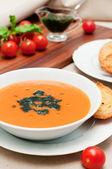 Fresh tomato soup with basil sauce — Stock Photo