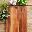 Cutting board with herbs — Stock Photo