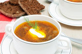Broth and bread — Stock Photo