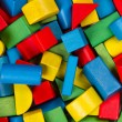 Toys blocks, multicolor wooden building bricks, heap of colorful game pieces — Stock Photo