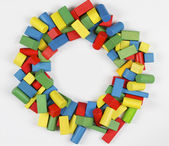 Toys blocks circle frame, multicolor wooden building bricks, group of colorful game pieces — Stock Photo