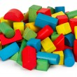 Toy blocks, multicolor wooden building bricks, heap of colorful game pieces — Stock Photo #43618933