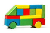 Toy bus, multicolor car wooden blocks, transport over white background — Stock Photo
