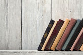 Old book shelf blank spines, empty binding stand on wood texture background, knowledge concept — Stock Photo