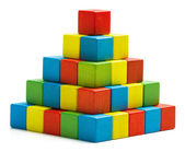 Toy blocks pyramid, multicolor wooden bricks stack isolated white background — Stock Photo