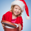 Happy small girl in Santa hat have a Christmas — Stock Photo #12588745