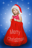 Little santa in red sack full of presents — Stock Photo