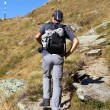 Man hiking, on mountain trail — Stock Photo