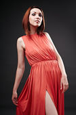 Redhead in red dress — Stock Photo