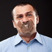 Silenced businessman — Stockfoto