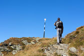 Man hiking, on mountain trail — Stock Photo