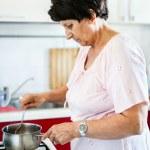 Senior woman preparing food — Stock Photo