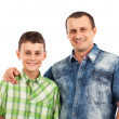 Father and son posing together in studio — Stock Photo