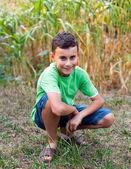 Handsome schoolboy posing outdoor in a garden — Stock Photo