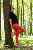 Young woman in the forest — Stock Photo